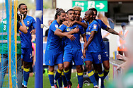 AFC Wimbledon striker Kweshi Appiah (9) celebrating after scoring goal to make it 1-0 during the EFL Sky Bet League 1 match between AFC Wimbledon and Doncaster Rovers at the Cherry Red Records Stadium, Kingston, England on 26 August 2017. Photo by Matthew Redman.