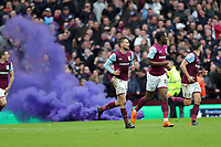 Aston Villa v Derby County - Sky Bet Championship<br /> BIRMINGHAM, ENGLAND - APRIL 28 :  Aston Villa players celebrate equalising as a flare goes off in the background