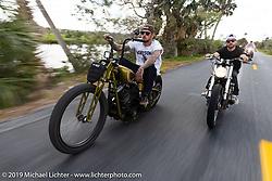 Nick Pensabene riding his custom chopper with his friend Mike Hendriks through Tomoka State Park during Daytona Bike Week. FL. USA. Sunday March 18, 2018. Photography ©2018 Michael Lichter.