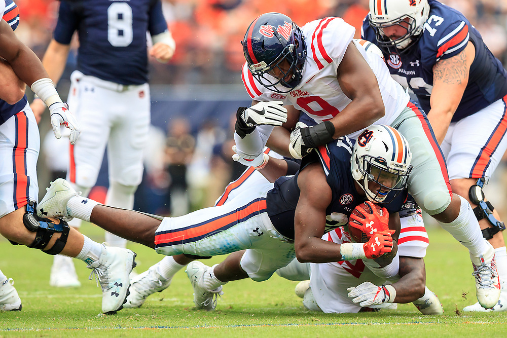 Auburn Tigers running back Kerryon Johnson (21) dives for extra yards against Mississippi Rebels defensive tackle Breeland Speaks (9) during an NCAA football game, Saturday, October 7, 2017, in Auburn, AL. Auburn won 44-23. (Paul Abell via Abell Images for Chick-fil-A Peach Bowl)