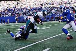 11 Jan 2009: Philadelphia Eagles safety Quintin Demps #39 i tackled by New York Giants safety Kenny Phillips #21 during the game against the New York Giants on January 11th, 2009.  The  Eagles won 23-11 at Giants Stadium in East Rutherford, New Jersey. (Photo by Brian Garfinkel)