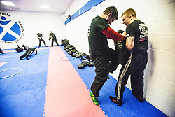 Students kneeing near the start of the session. Stef Noij, KMG Instructor from the Institute Krav Maga Netherlands, takes the IKMS G Level Programme seminar today at the Scottish Martial Arts Centre, Alloa.