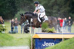 Jung Michael (GER) - Fischer Rocana FST <br /> Cross Country <br /> CCI4*  Luhmuhlen 2014 <br /> © Hippo Foto - Jon Stroud