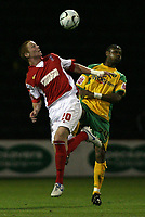 Photo: Paul Thomas.<br /> Rotherham United v Norwich City. Carling Cup. 19/09/2006.<br /> <br /> Ryan Taylor (L) of Rotherham wins the ball from Jurgen Colin.