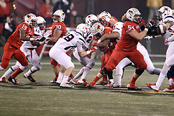 11 December 2015:  Marshaun Coprich(25) attempts to squeeze through the middle. NCAA FCS Quarter Final Football Playoff game between Richmond Spiders and Illinois State Redbirds at Hancock Stadium in Normal IL (Photo by Alan Look)