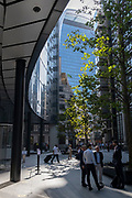 In the week that many more Londoners returned to their office workplaces after the Covid pandemic, workers sit and walk through September sunshine on Lime Street in the City of London, the capital's financial district, on 8th September 2021, in London, England.