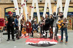 © Licensed to London News Pictures. 16/03/2016. London, UK. (L to R)  Magic Shaun, King Charles, Charlie Hole, CC Smugglers, Lady of Stone and Luca Fiore pose for a group photo. These buskers and street performers entertained morning commuters in King's Cross station, as this year's Busk in London programme is launched.  Supported by the Mayor of London, the festival joins the International Busking Day and National Busking Day initiatives to celebrate street performances. Photo credit : Stephen Chung/LNP