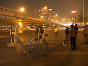 pedestrians and bicycle cart waiting to cross a road Beijing China