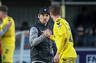 Fleetwood Town manager Joey Barton shaking hands with Fleetwood Town defender Lewis Coyle (2) during the EFL Sky Bet League 1 match between AFC Wimbledon and Fleetwood Town at the Cherry Red Records Stadium, Kingston, England on 8 February 2020.