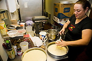 Lourdes Alvarez prepares a cake at her Mexican Restaurant, El Coyote in the suburb of Alsip, Chicago, Illinois. (Lourdes Alvarez is featured in the book What I Eat;  Around the World in 80 Diets.)   MODEL RELEASED.