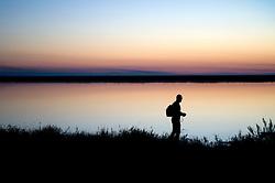 Il complesso produttivo delle saline è situato nel comune italiano di Margherita di Savoia (nome dato dagli abitanti in onore alla regina d'Italia che molto si adoperò nei confronti dei salinieri) nella provincia di Barletta-Andria-Trani in Puglia. Sono le più grandi d'Europa e le seconde nel mondo, in grado di produrre circa la metà del sale marino nazionale (500.000 di tonnellate annue).All'interno dei suoi bacini si sono insediate popolazioni di uccelli migratori e non, divenuti stanziali quali il fenicottero rosa, airone cenerino, garzetta, avocetta, cavaliere d'Italia, chiurlo, chiurlotello, fischione, volpoca..La sagoma di un visitatore si staglia sullo sfondo dela tramonto sulle acque di un bacino.