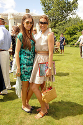 Left to right, AMBER LE BON and YASMIN LE BON at a luncheon hosted by Cartier for their sponsorship of the Style et Luxe part of the Goodwood Festival of Speed at Goodwood House, West Sussex on 4th July 2010.