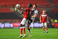 Famara Diedhiou (9) of Bristol City battles for possession with Jack Hobbs (14) of Bolton Wanderers during the The FA Cup fourth round match between Bristol City and Bolton Wanderers at Ashton Gate, Bristol, England on 25 January 2019.