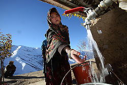 Noqra 13 years old collects water from  a standpipe. This standpipe and others are part of a wider gravity flow drinking water system and WASH project supported by NCA, Falalij   Village Daikundi, Afghanistan.