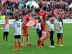 Jamie Paterson and Tammy Abraham of Bristol City with flag bearers from Portishead Town FC after the break at Ashton Gate Stadium - Mandatory by-line: Paul Knight/JMP - 01/10/2016 - FOOTBALL - Ashton Gate Stadium - Bristol, England - Bristol City v Nottingham Forest - Sky Bet Championship