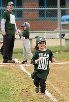 Julia Zegarelli doing some warm up drills around the bases with her T Ball Team WB (Wilkinson Beane) as opening day got underway Saturday morning for Laconia Little League.  (Karen Bobotas/for the Laconia Daily Sun)