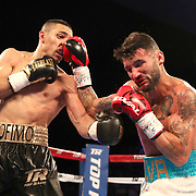 NEW ORLEANS, LA - JULY 14:  Teofimo Lopez (L) and William Silva exchange blows during their WBC Continental Americas Title boxing match at the UNO Lakefront Arena on July 14, 2018 in New Orleans, Louisiana.  (Photo by Alex Menendez/Getty Images) *** Local Caption *** Teofimo Lopez; William Silva