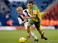 Photo: Leigh Quinnell.<br /> West Bromwich Albion v Norwich City. Coca Cola Championship. 11/11/2006. Norwichs' Darren Huckerby gets past West Broms Paul McShane.