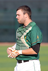 11 August 2012:  Catcher Trey Manz during a Frontier League Baseball game between the River City Rascals and the Normal CornBelters at Corn Crib Stadium on the campus of Heartland Community College in Normal Illinois.  The CornBelters take this game in 9 innings 7 - 2 with a 5 run 2nd inning.