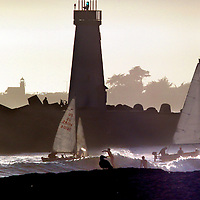 Both Santa Cruzl lighthouses are visible in the late afternoon sun as sailboats, surfers and seagulls converge at the mouth of the Santa Cruz Small Craft Harbor.<br /> Photo by Shmuel Thaler <br /> shmuel_thaler@yahoo.com www.shmuelthaler.com