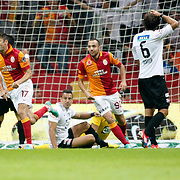Galatasaray's celebrates his goal Burak Yilmaz, Sercan Yildirim (L-R) during their Turkish Super League soccer match Galatasaray between Akhisar Belediyespor at the TT Arena at Seyrantepe in Istanbul Turkey on Sunday 23 September 2012. Photo by TURKPIX