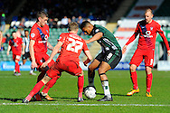Plymouth Argyle's Reuben Reid path is blocked by York City's Luke Hendrie and other York players during the Sky Bet League 2 match between Plymouth Argyle and York City at Home Park, Plymouth, England on 28 March 2016. Photo by Graham Hunt.