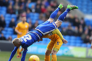 Lex Immers of Cardiff city (27) falls over the top of Tom Clarke of Preston.  Skybet football league championship match, Cardiff city v Preston NE at the Cardiff city stadium in Cardiff, South Wales on Saturday 27th Feb 2016.<br /> pic by  Andrew Orchard, Andrew Orchard sports photography.
