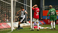 Photo:  Frances Leader.<br /> Luton Town FC v Milton Keynes Dons. The Coca-Cola League One. Kenilworth Road.<br /> 16/04/05<br /> The Dons captain Ben Chorley scores an own goal to bring the half time score to 1-0 as he lies degected as goalie Matt Baker and team mate Trent McClenahan look on and Lutons' Steve Holland celebrates.
