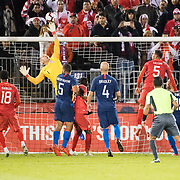 EAST HARTFORD, CONNECTICUT- October 16th: Goalkeeper Brad Guzan #1 of the United States fingertips away a last minute free kick to help the United States hold onto a 1-1 draw during the United States Vs Peru International Friendly soccer match at Pratt & Whitney Stadium, Rentschler Field on October 16th 2018 in East Hartford, Connecticut. (Photo by Tim Clayton/Corbis via Getty Images)