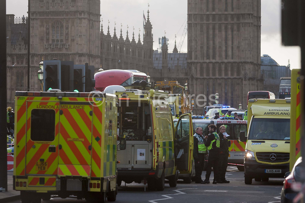 Scenes on Westminster Bridge after four people were killed including the attacker and 20 injured during a terrorist attack on Westminster Bridge and outside the Houses of Parliament, on 22nd March 2017, in central London, England. Parliament was in session and all MPs and staff and visitors were in lock-down while outside, the public and traffic were kept away from the area of Westminster Bridge and parliament Square, the scenes of the attack. It is believed a lone man crashed his car into pedestrians then, armed with a knife tried to enter Parliament, stabbing and killing a police officer at parliaments main gates.