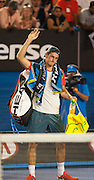 Bernard Tomic (AUS) faced R. Nadal (ESP) in day two play of the 2014 Australian Open at Melbourne's Rod Laver Arena. Tomic forfeited the match blaming leg pain - here, leaving the court - giving Nadal the win. One set was completed during match play with Nadal up 6-4.