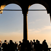 Tourists of the Topkapi Palace with arches.