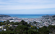 View of the district of Lyall Bay, New Zealand with the blue water of Fitzroy Bay and the Cook Strait beyond