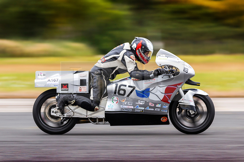 © Licensed to London News Pictures. 15/09/2018. York UK. European motorcycle champion Katy Calmon rides a prototype bike today at Elvington Airfield near York in an attempt to establish a new world speed record for Partial streamlined 500cc bikes over 1 mile. The bike designed by a team of french apprentice engineers who recently graduated from I'ITII in Normandy is loosely based on a Ducati 999R & is frameless as the machined engine housing is integrated into the rear wheel with the radiator on the back. The team started the project three years ago & have designed & built the bike from scratch. Photo credit: Andrew McCaren/LNP