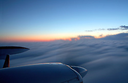 Flying above clouds over Kansas..Photo by Matt Cashore..Use of this image prohibited without authorization and/or compensation..To contact Matt Cashore:.574.220.7288.cashore1@michiana.org.www.mattcashore.com
