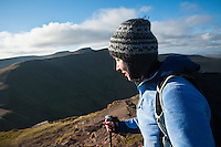 Female hiker with Pen Y Fan in distance, Brecon Beacons national park, Wales