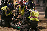 A protestor was arrested after he scuffled with police during late-night clashes with police in central London on Wednesday, June 3, 2020. (Photo/ Vudi Xhymshiti)