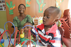 Mothers and children at Save the Children Australia's It Takes a Village ... Multicultural Early Learning Centre in Western Australia