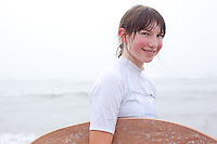 Rachael Vega prepares to skim board on the beach near Newport, Oregon.