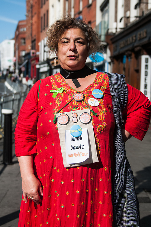 """Dublin, Ireland. 25th August, 2018. <br /> An Irish survivor pose for a portrait along the streets of Dublin just ahead the speech of the Pope during the first of the two-days of the visit of Pope Francis in Dublin, Ireland.<br /> Pope Francis has made a two-day visit to the Republic of Ireland by celebrating a Mass at Dublin's Phoenix Park. The Argentine Pope asked forgiveness for the """"abuses in Ireland, abuses of power, conscience and sexual abuses"""" perpetrated by Church leaders. It was the first papal visit to Ireland for 39 years. During his activities many activists, victims and survivors have made protests and a silent march Garden of Remembrance towards the last Magdalene Laundry to close in Ireland.<br />  © Simone Padovani"""