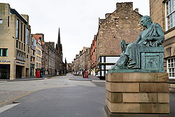 Edinburgh, Scotland, UK. 4 April, 2020. On the second weekend of the coronavirus lockdown in the UK the Royal Mile lies completely silent and deserted. Iain Masterton/Alamy Live News