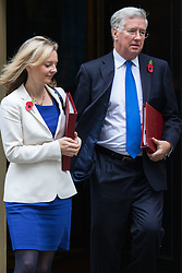 Downing Street, London, November 3rd 2015.  Defence Secretary Michael Fallon and Agriculture Secretary Liz Truss leave 10 Downing Street after attending the weekly cabinet meeting. /// Licencing: Paul@pauldaveycreative.co.uk Tel:07966016296 or 020 8969 6875