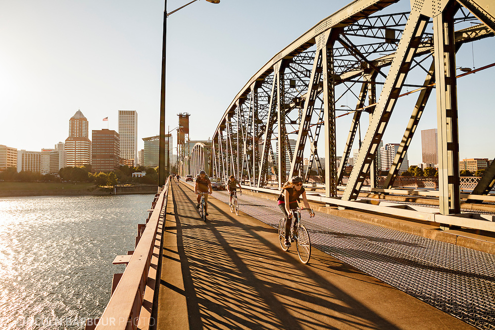 Cyclicsts and commuters cross the Hawthorne Bridge in Portland, OR.
