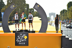 Tour de France 2018 winner Great Britain's Geraint Thomas (C), wearing the overall leader's yellow jersey, second-placed Netherlands' Tom Dumoulin (L) and third-placed Great Britain's Christopher Froome (R) celebrate on the podium after the 21st and last stage of the 105th edition of the Tour de France cycling race between Houilles and Paris Champs-Elysees, in Paris, France, on July 29, 2018. Photo by Eliot Blondet/ABACAPRESS.COM
