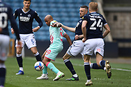 Swansea City Forward André Ayew(10) and Millwall defender Scott Malone(14)  battles for possession during the EFL Sky Bet Championship match between Millwall and Swansea City at The Den, London, England on 10 April 2021.
