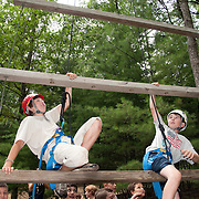 Boys climb a ropes course at a summer camp in Massachusetts