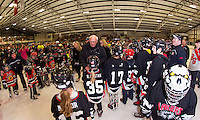 "Merrill Fay is welcomed onto the ice by a large crowd of ""lakers"" during the celebration in his honor naming the Laconia Ice Arena the ""Merrill Fay Arena"" on Friday evening.  (Karen Bobotas/for the Laconia Daily Sun)"