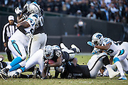 Oakland Raiders running back Latavius Murray (28) dives over the line of scrimmage against the Carolina Panthers at Oakland Coliseum in Oakland, Calif., on November 27, 2016. (Stan Olszewski/Special to S.F. Examiner)