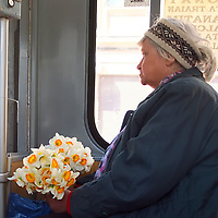 TIMISOARA, ROMANIA - APRIL 21:  A woman carrying a bunch of flowers is seen on a tram on April 21, 2013 in Timisoara, Romania.  Romania has abandoned a target deadline of 2015 to switch to the single European currency and will now submit to the European Commission a programme on progress towards the adoption of the Euro, which for the first time will not have a target date. (Photo by Marco Secchi/Getty Images)