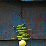 Chilli peppers and lime strnged together as a good luck charm. Old Delhi, MArch 2007